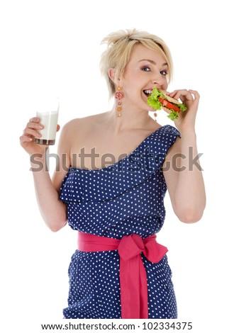 beautiful girl eating sandwich. isolated on white background - stock photo