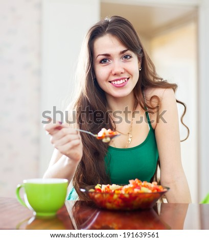 beautiful girl eating vegetarian lunch at home - stock photo