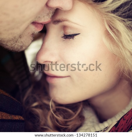 beautiful girl embraces the guy - stock photo
