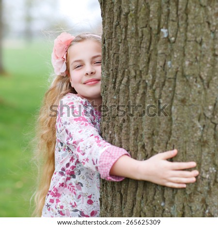 beautiful girl embracing a tree environmental concept - stock photo