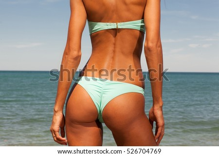 Beautiful girl enjoins hot sunny day at the beach.