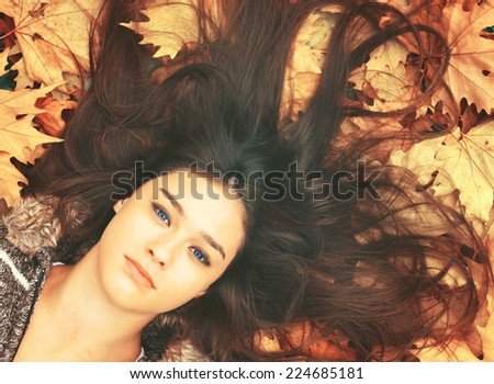 Beautiful girl enjoying nature in autumn forest - stock photo