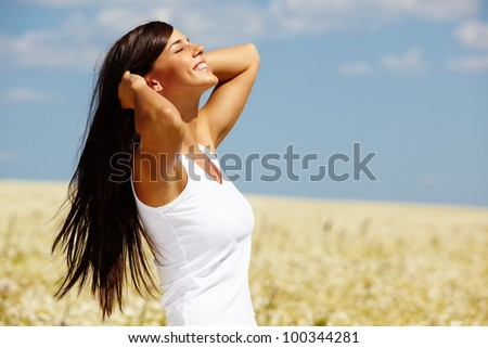 Beautiful girl enjoying the sun and the warmth - stock photo