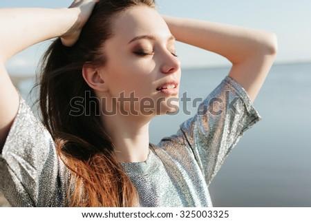 Beautiful girl enjoying the sun and the warmth - stock photo