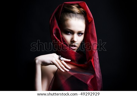 beautiful girl enveloped  in red headscarf. Fashion photo - stock photo