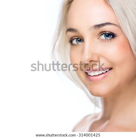 Beautiful girl face on white background - stock photo