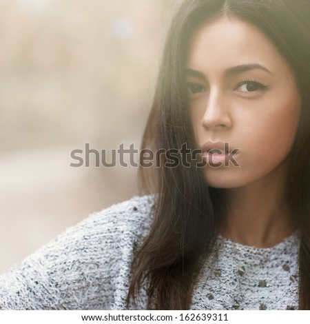 Beautiful girl face - outdoors portrait  - stock photo