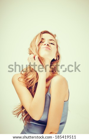 beautiful girl face with a hand - stock photo