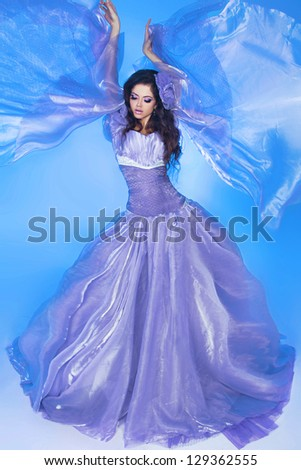 Beautiful Girl . Fashion woman in Blowing Dress Flying - stock photo
