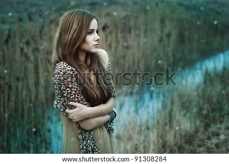Beautiful girl freezing - stock photo