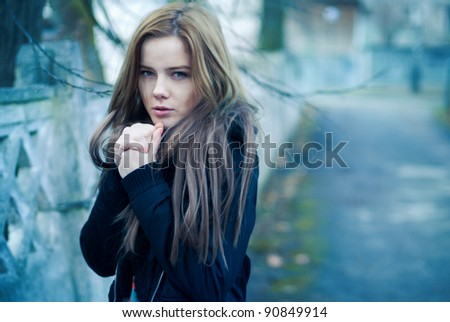 Beautiful girl freezing in the street - stock photo