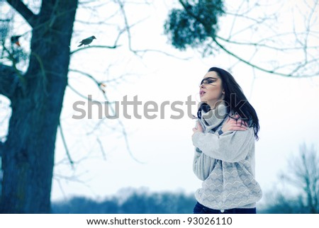beautiful girl freezing in the winter - stock photo