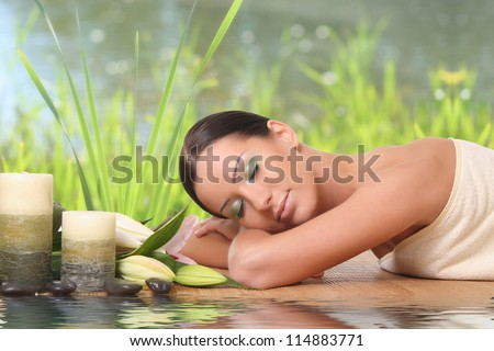 beautiful girl gets a nice stay at a spa - stock photo