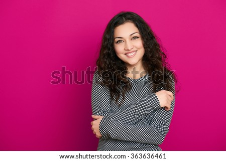 beautiful girl glamour portrait on pink background, long curly hair - stock photo