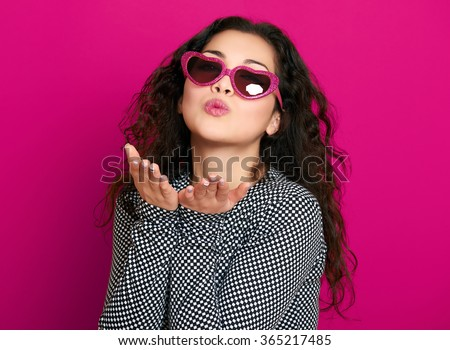 beautiful girl glamour portrait on pink make flying kiss - stock photo