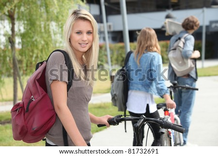 beautiful girl go to the university with her friends - stock photo