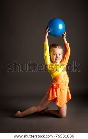 Beautiful girl gymnast with a ball - stock photo