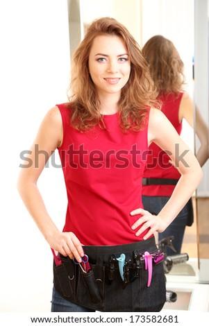Beautiful girl hairdresser in beauty salon  - stock photo