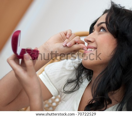 Beautiful girl has a ring as a gift - stock photo