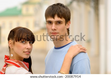 Beautiful girl has put hand on shoulder of beloved.