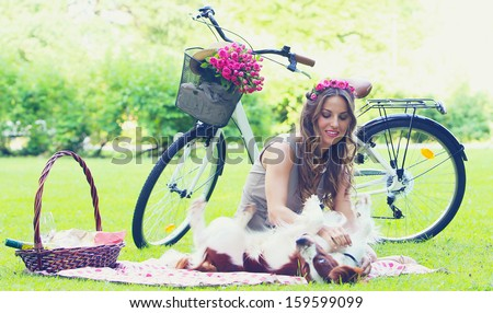 Beautiful girl having a picnic in a park - stock photo