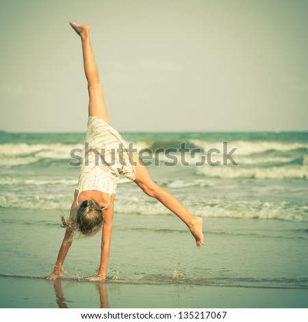 Beautiful girl having fun at beach