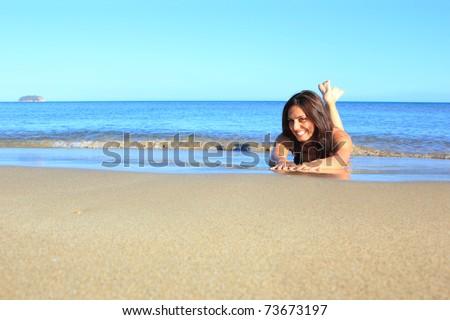 Beautiful girl having fun in the sea in Italy - stock photo