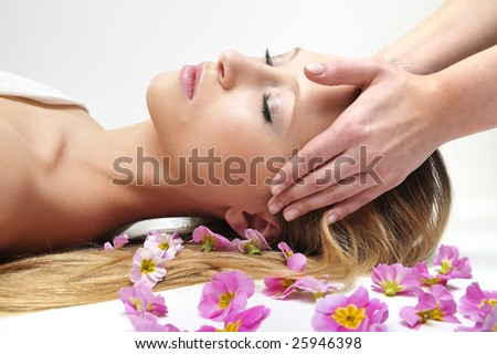 Beautiful girl having massage in spa - stock photo
