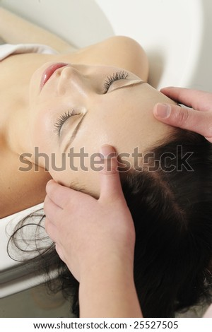 Beautiful girl having massage in spa , Enjoy nice time.. - stock photo