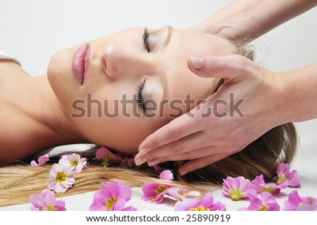 Beautiful girl having massage in spa , Enjoy nice time... - stock photo