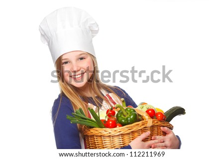 beautiful girl holding a basket full of healthy vegetables - stock photo