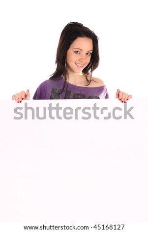 Beautiful girl holding a blank over white background
