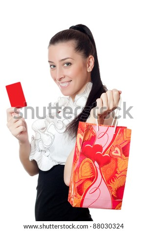 beautiful girl holding a credit card - stock photo