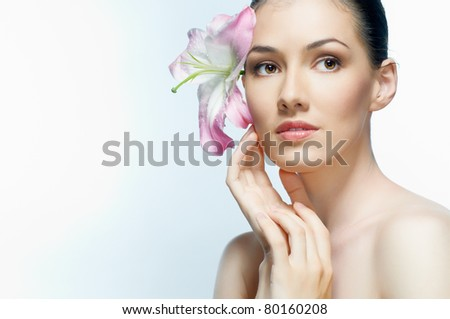 beautiful girl holding a flower - stock photo