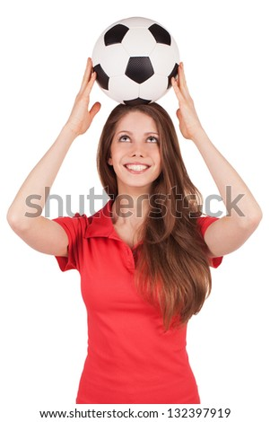 Beautiful girl holding a soccer ball on his head - stock photo