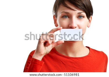 beautiful girl holding an empty business card, hiding her mouth - stock photo
