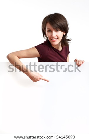 beautiful girl holding an empty white board and pointing her finger down - stock photo