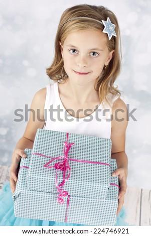 Beautiful girl holding christmas presents - stock photo