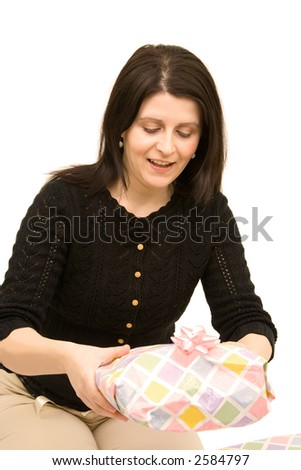 beautiful girl holding gift isolated on a white background. - stock photo