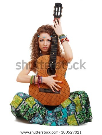 Beautiful Girl holding guitar on white background in hippie outfit isolated - stock photo