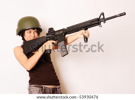 Beautiful girl holding gun. - stock photo