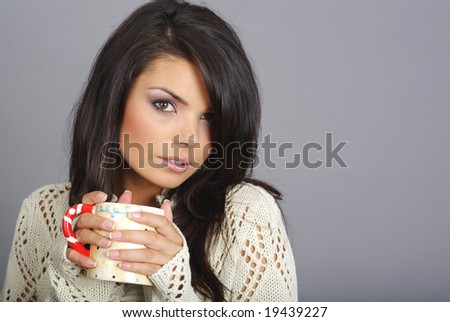 Beautiful girl holding hot coffee drink