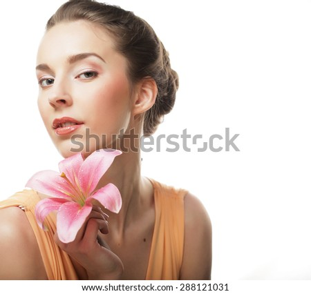 Beautiful girl holding lily flower in her hands - stock photo