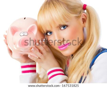 Beautiful girl holding piggy bank on white background  - stock photo