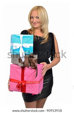 Beautiful girl holding stack of gift boxes, isolated on white background