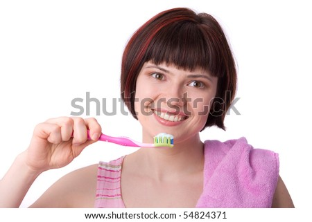 Beautiful girl holding up a toothbrush that contains tooth paste. Young Woman cleaning her teeth. - stock photo