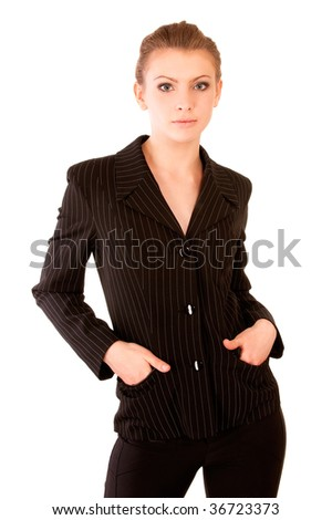 Beautiful girl holds hands in suit pockets, it is isolated on white background.