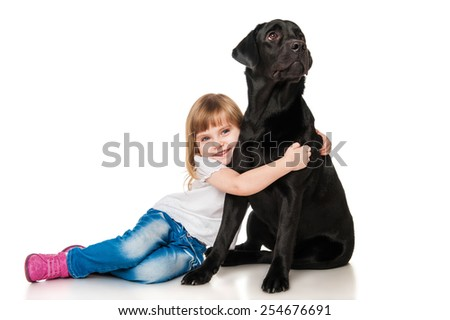Beautiful girl hugging a black Labrador - stock photo