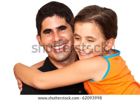 Beautiful girl hugging a smiling young man on a white background - stock photo