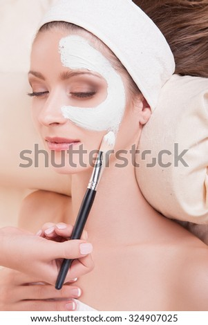 Beautiful girl in a beauty salon on the procedures for rejuvenation, skin lifting.Lovely woman with soft skin lying on his back in the salon spa. Beauty. Cosmetology. Beautiful female face.Makeup - stock photo
